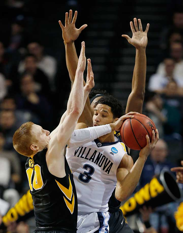 Iowa guard Mike Gesell defends as Villanova's Josh Hart looks to pass.