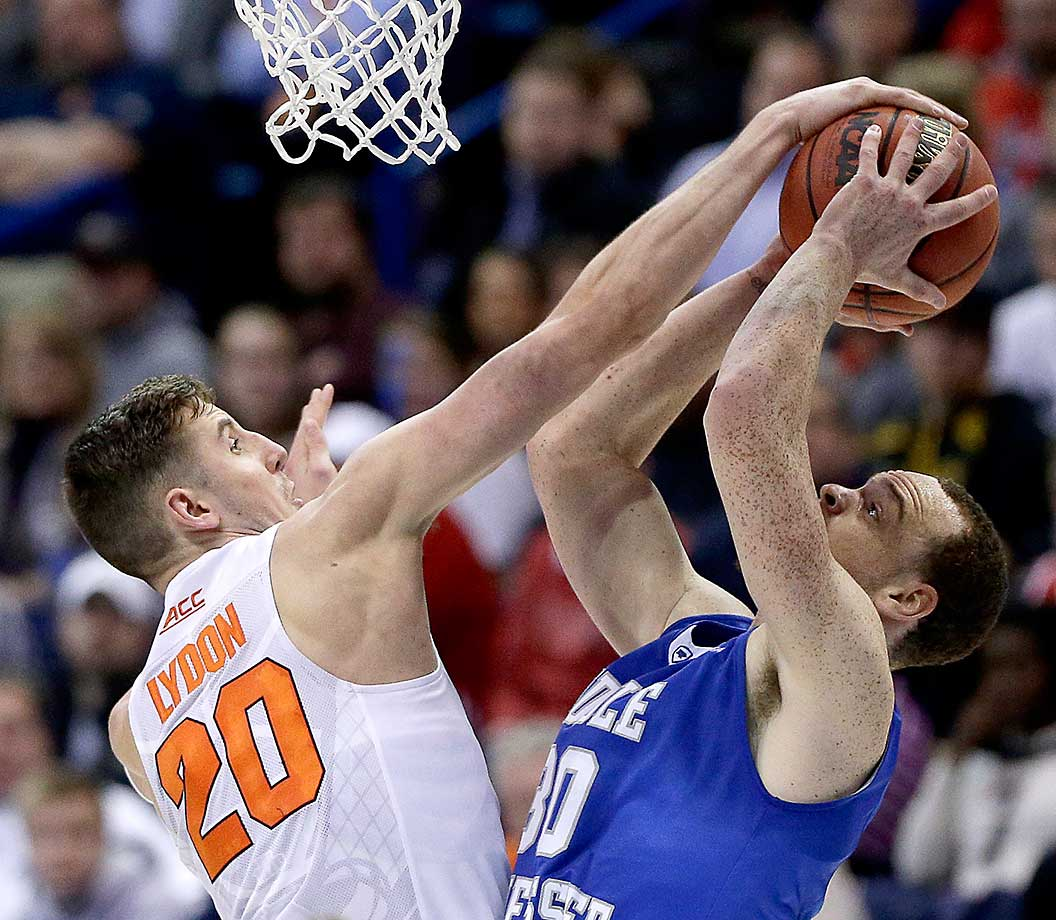 Tyler Lydon of Syracuse blocks a shot by Middle Tennessee's Reggie Upshaw Jr. during a 75-50 romp.