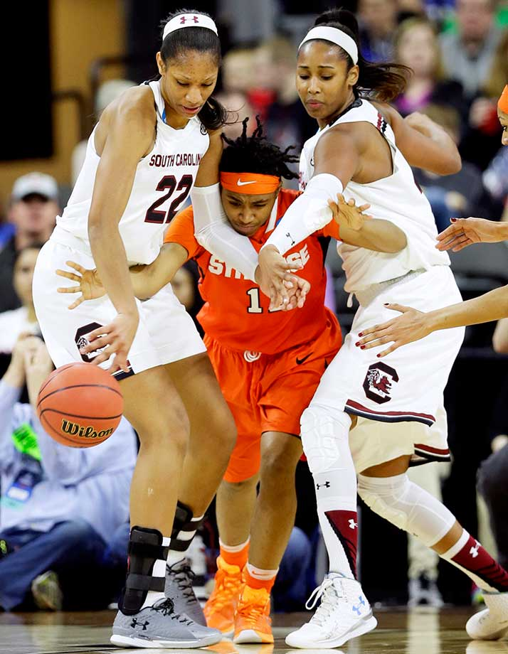 Syracuse guard Cornelia Fondren fights for the ball with South Carolina's A'ja Wilson, left, and Alaina Coates.