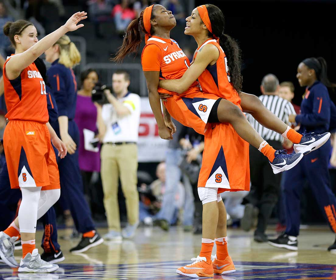 Syracuse guard Alexis Peterson celebrates with teammate Briana Day after the Orange knocked off No. 1 seed South Carolina in the NCAA Tournament.