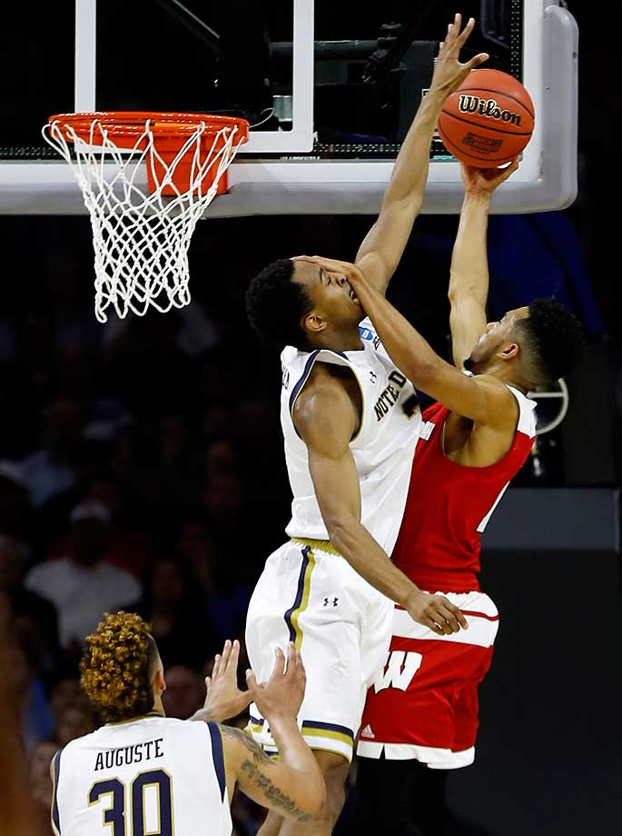 Wisconsin's Jordan Hill puts a hand to the face of Notre Dame's V.J. Beachem while trying to help his team reach the Elite Eight.