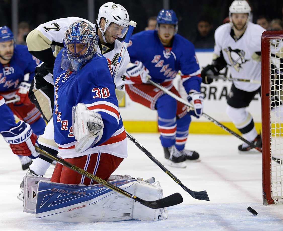 Pittsburgh's Matt Cullen (7) scores past New York Rangers goalie Henrik Lundqvist.