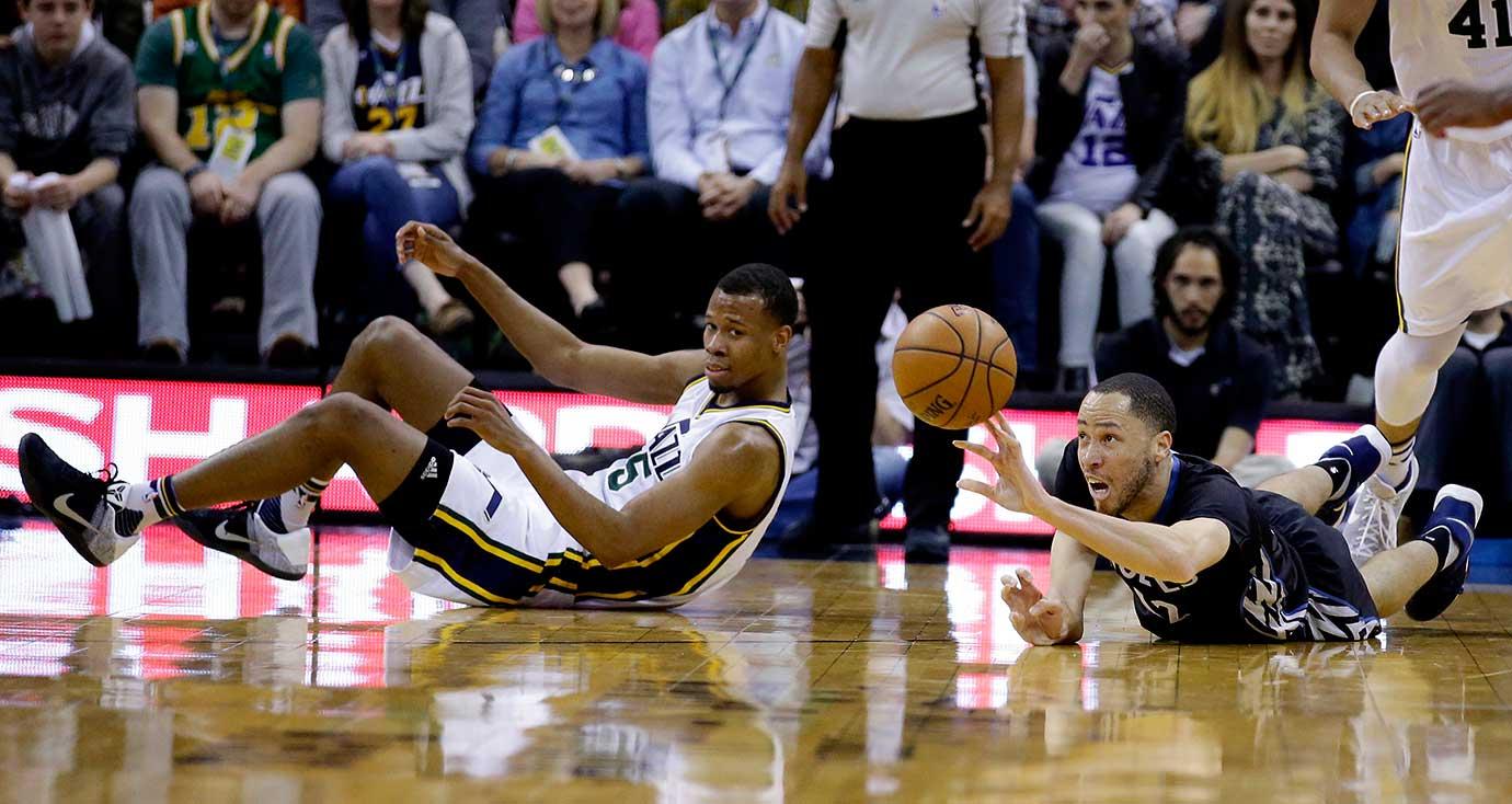 Minnesota forward Tayshaun Prince passes the ball as Utah Jazz guard Rodney Hood looks on.