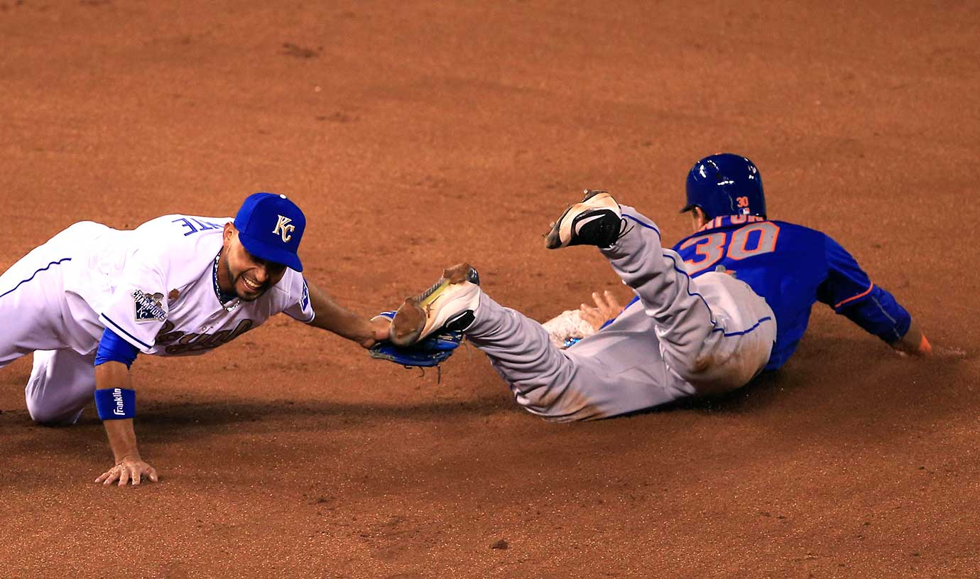 Kansas City second baseman Omar Infante tags out Michael Conforto of the New York Mets in Sunday's World Series rematch.