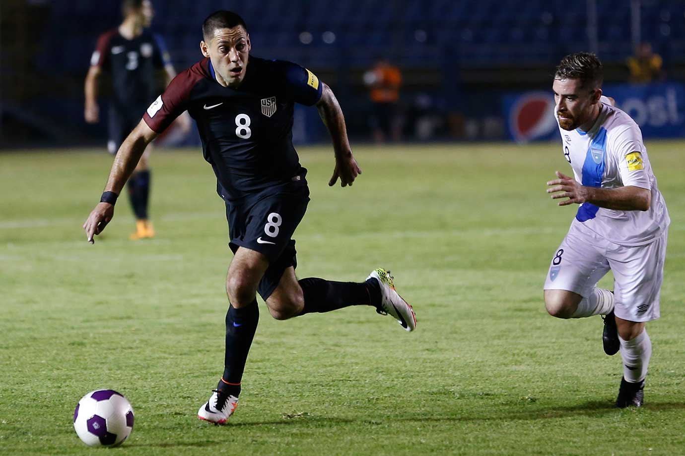 Clint Dempsey of the U.S. and Jean Marquez of Guatemala fight for the ball during a 2018 World Cup qualifying match that the Americans lost 2-0.