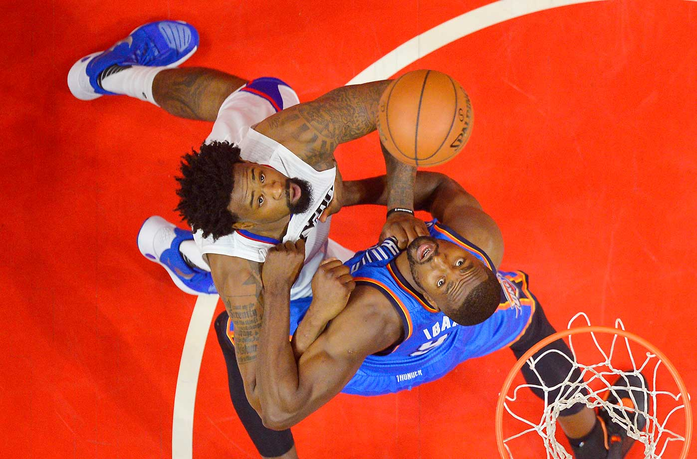 Clippers center DeAndre Jordan and Thunder forward Serge Ibaka watch a rebound during their game in L.A.