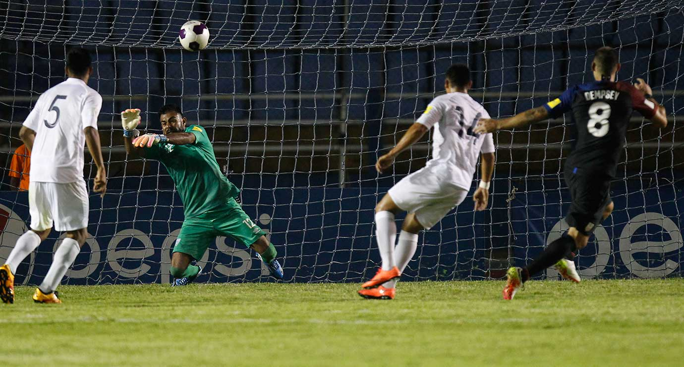 Goalkeeper Paulo Motta  blocks a shot by Clint Dempsey of the U.S. during a 2018 World Cup qualifying match that Guatemala won 2-0.