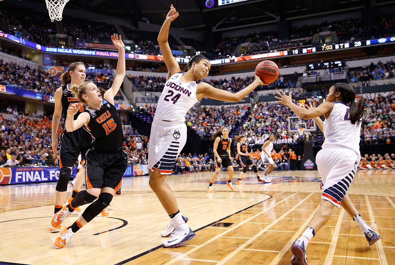 Connecticut's Napheesa Collier controls a rebound and starts a fast break with teammate Moriah Jefferson (4).
