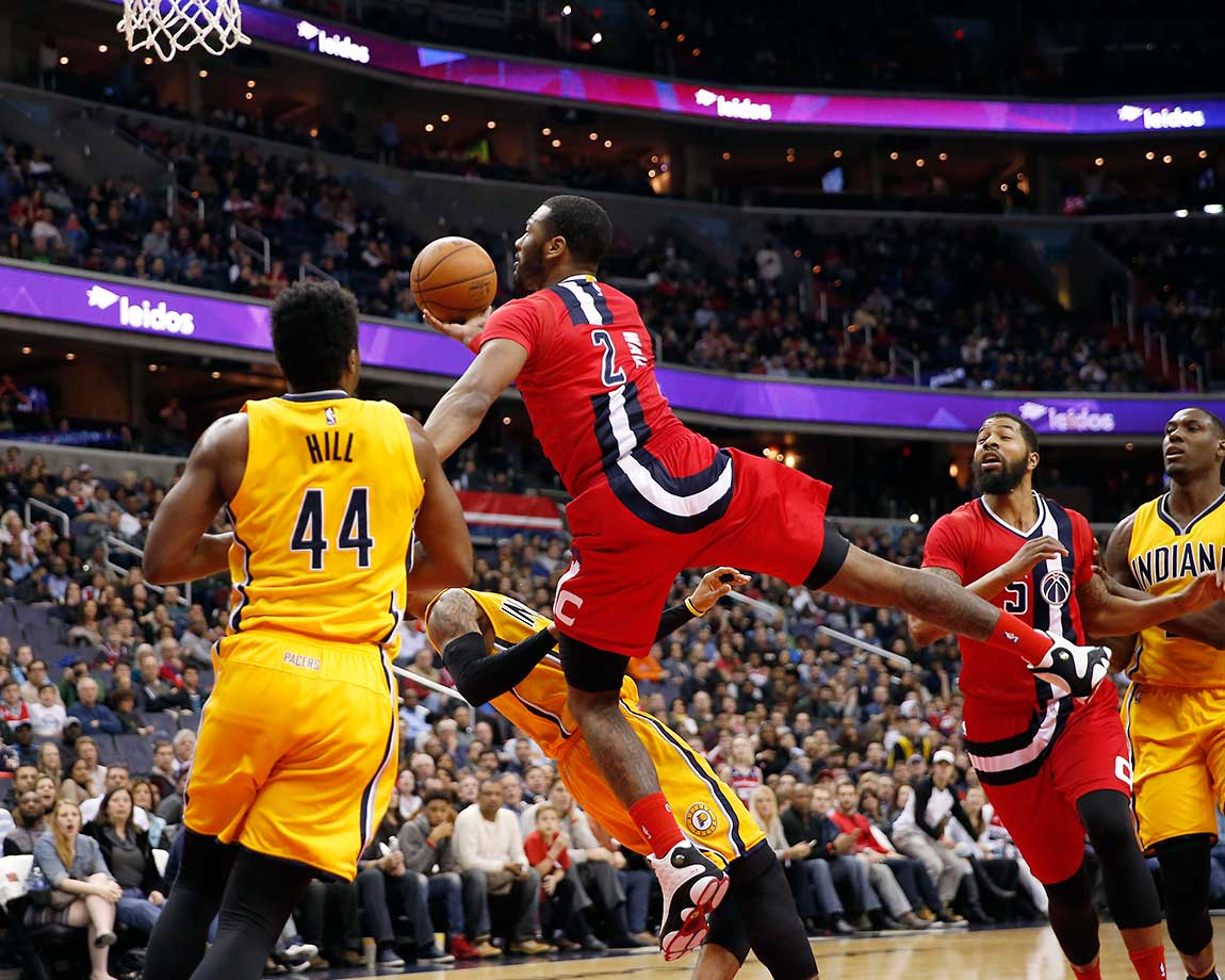 Washington Wizards guard John Wall shoots as he is fouled by Indiana's Monta Ellis.
