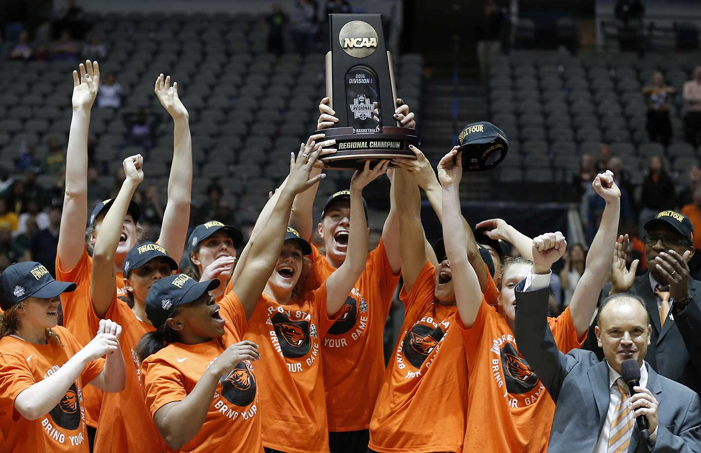 Oregon State celebrates winning 60-57 over Baylor in a regional final of the women's NCAA tournament.
