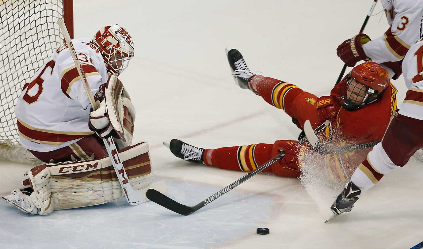 Denver goalie Tanner Jaillet deflects a shot by Ferris State's Matt Robertson during Denver's 6-3 win in the NCAA West Regional championship game.