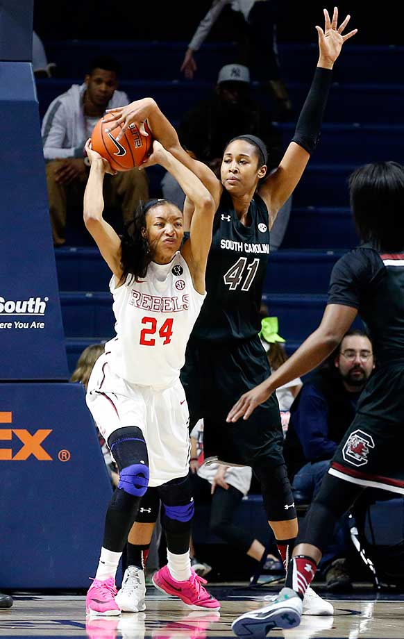 South Carolina center Alaina Coates blocks a pass from Mississippi forward Bretta Hart.