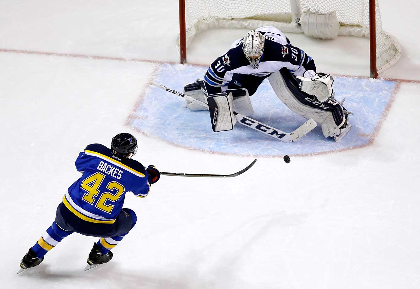 Winnipeg Jets goalie Connor Hellebuyck stops a shot from St. Louis Blues' David Backes.