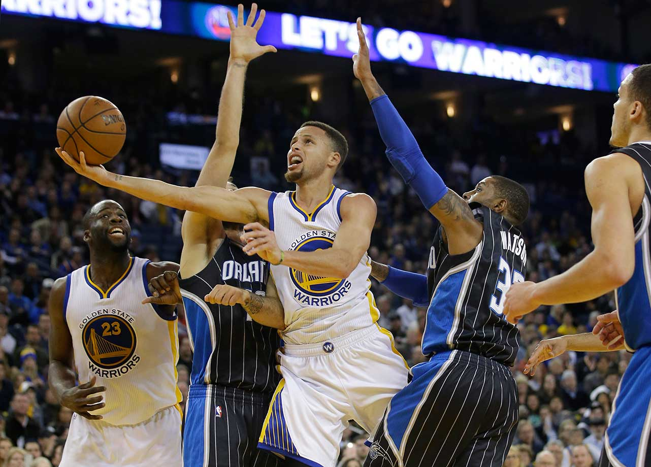 Stephen Curry puts up a shot against the Orlando Magic.