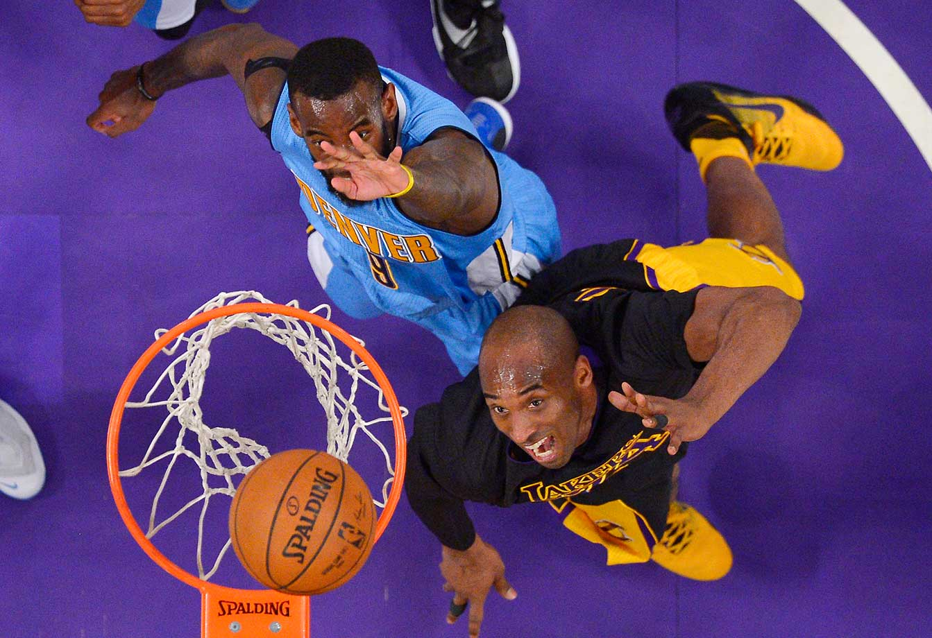 Lakers forward Kobe Bryant shoots as Denver Nuggets guard JaKarr Sampson defends.