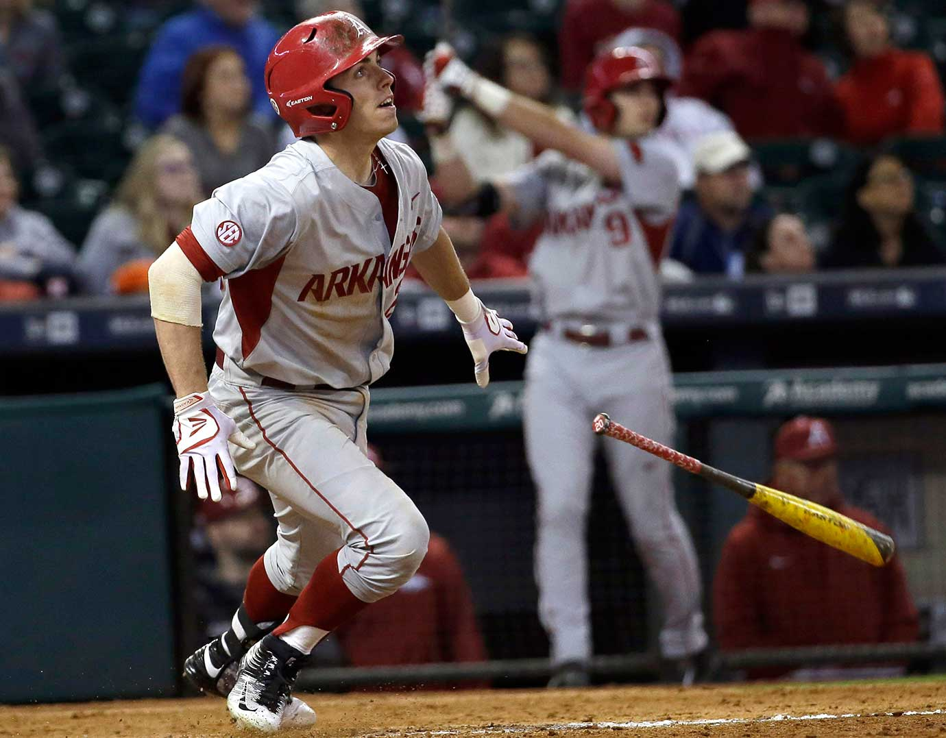Carson Shaddy of Arkansas watches his sacrifice fly that scored Michael Bernal against Rice.