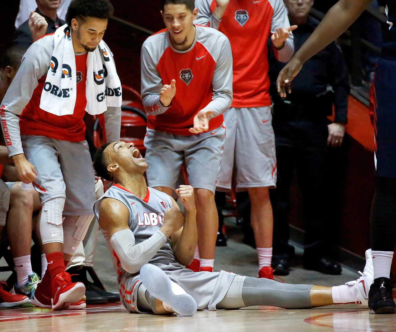 New Mexico's Elijah Brown reacts after making a shot against Fresno State.