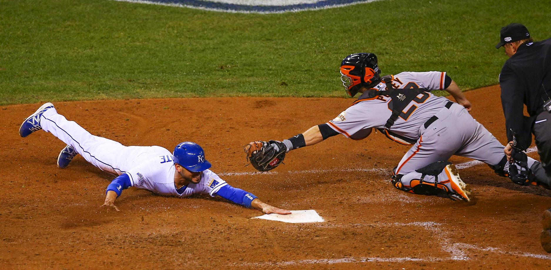 Royals second baseman Omar Infante scores in the fifth inning.