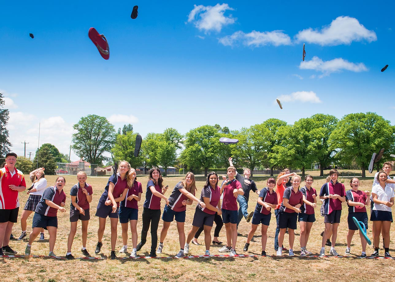 Children from Armidale High School, NSW, Australia participating in the Guinness World Records title attempt for the Most people throwing thongs (flip-flops) simultaneously, in honor of Guinness World Records Day on Nov. 12, 2014.