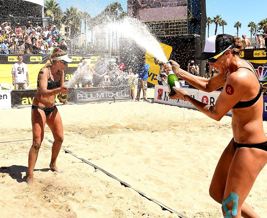 The champagne rains for April Ross and Lauren Kendrick at the AVP Kingston Beach Volleyball Championships at Huntington Beach.