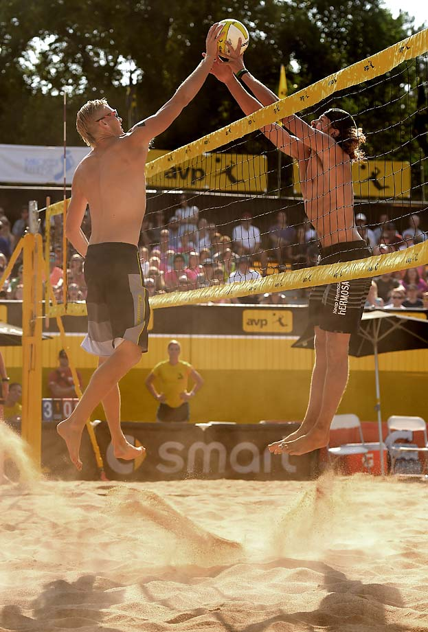 Casey Patterson (L) and jeremy  Casebeer joust at the net in the mens semis.