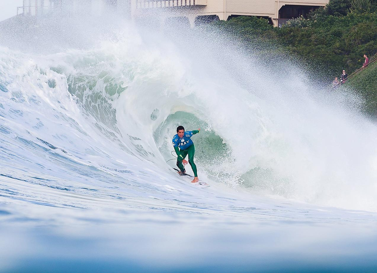 Adriano de Souza of Brazil rides a wave at the J-Bay Open at Supertubes in Jeffreys Bay, South Africa.