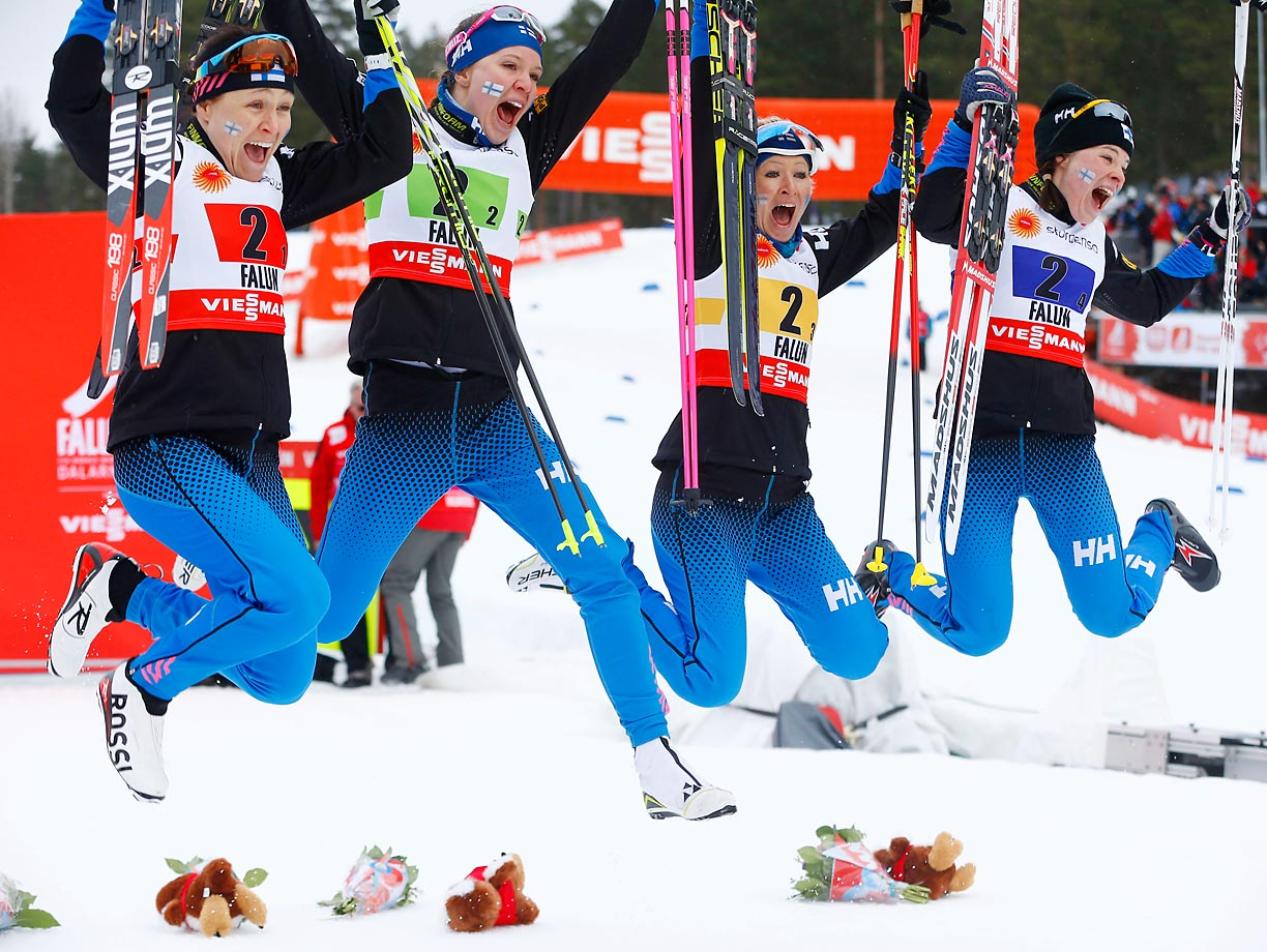 Finland's Aino-Kaisa Saarinen, Kerttu Niskanen, Ritta Llisa Roponen and Krista Parmakoski celebrate after finishing third in the 4x5 km relay at the Nordic Skiing World Championships in Falun, Sweden.