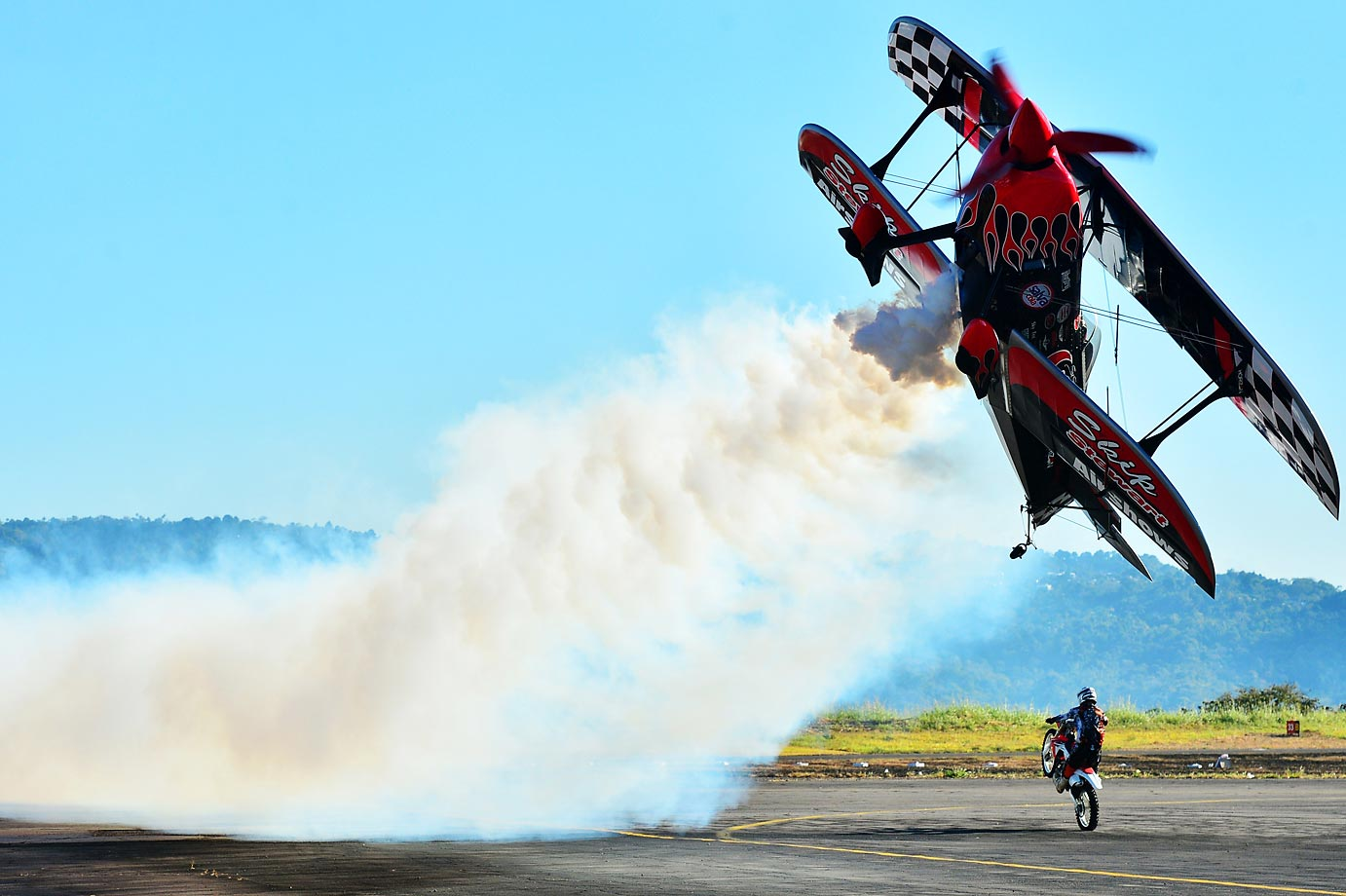 Skip Stewart of the U.S. performs a stunt during the Ilopango Air Show in San Salvador.