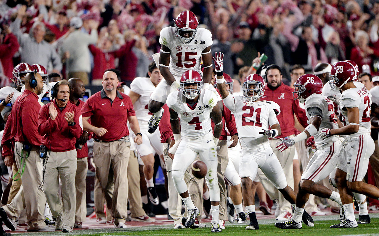 Alabama players show their excitement over a first-half touchdown.