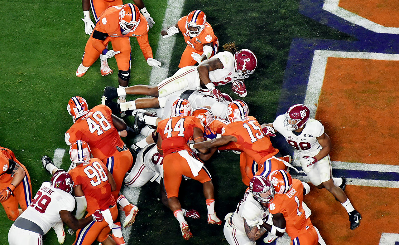 Derrick Henry scored on two one-yard runs and became Alabama's career rushing leader in the game.