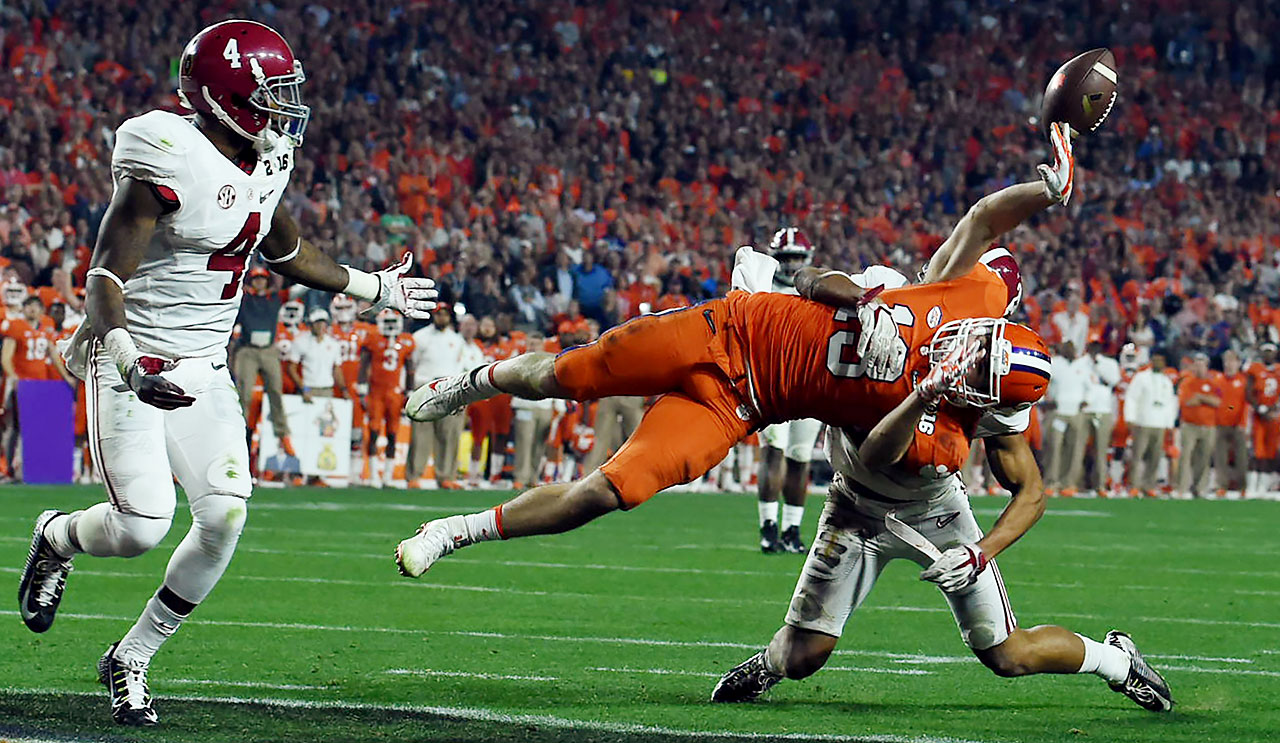 Hunter Renfrow of Clemson is toppled before he can make a third touchdown reception.