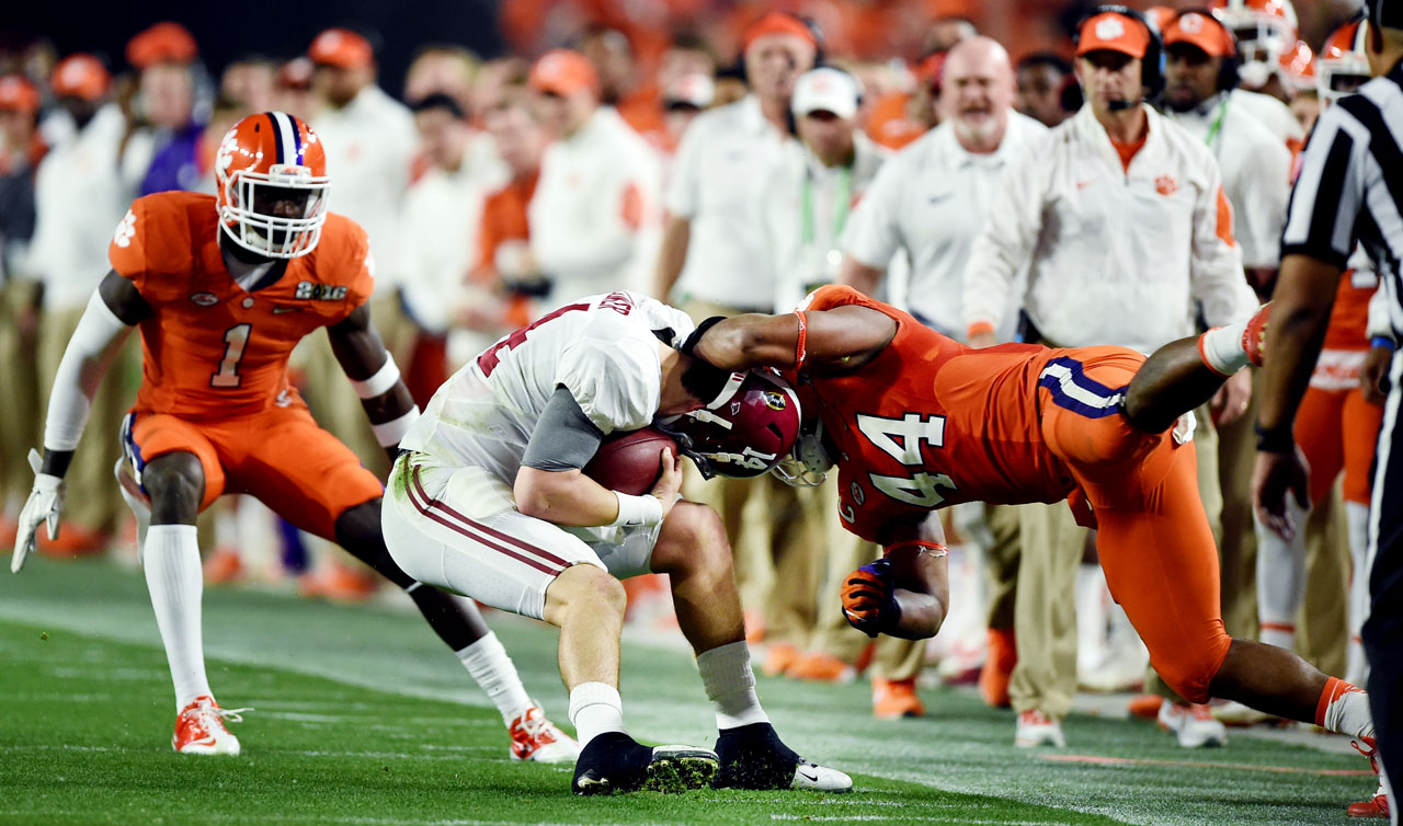 Clemson's Levi Wallace attempts to bring down Jake Coker.