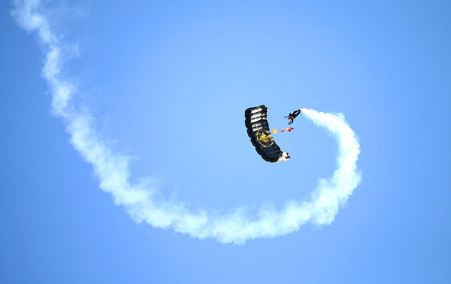 A parachutist enters the stadium before the Mississippi State game at Alabama.