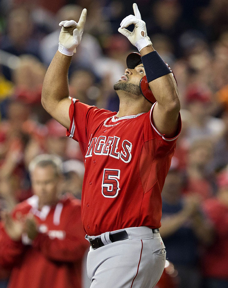 With a pair of home runs against Washington in Los Angeles' 7-2 win on April 22, 2014, Pujols became just the 26th player in baseball history to reach 500 career homers. Pujols is the first player to hit his 499th and 500th career homers in the same game and joins Alex Rodriguez as the only active players in baseball to be a part of that group.