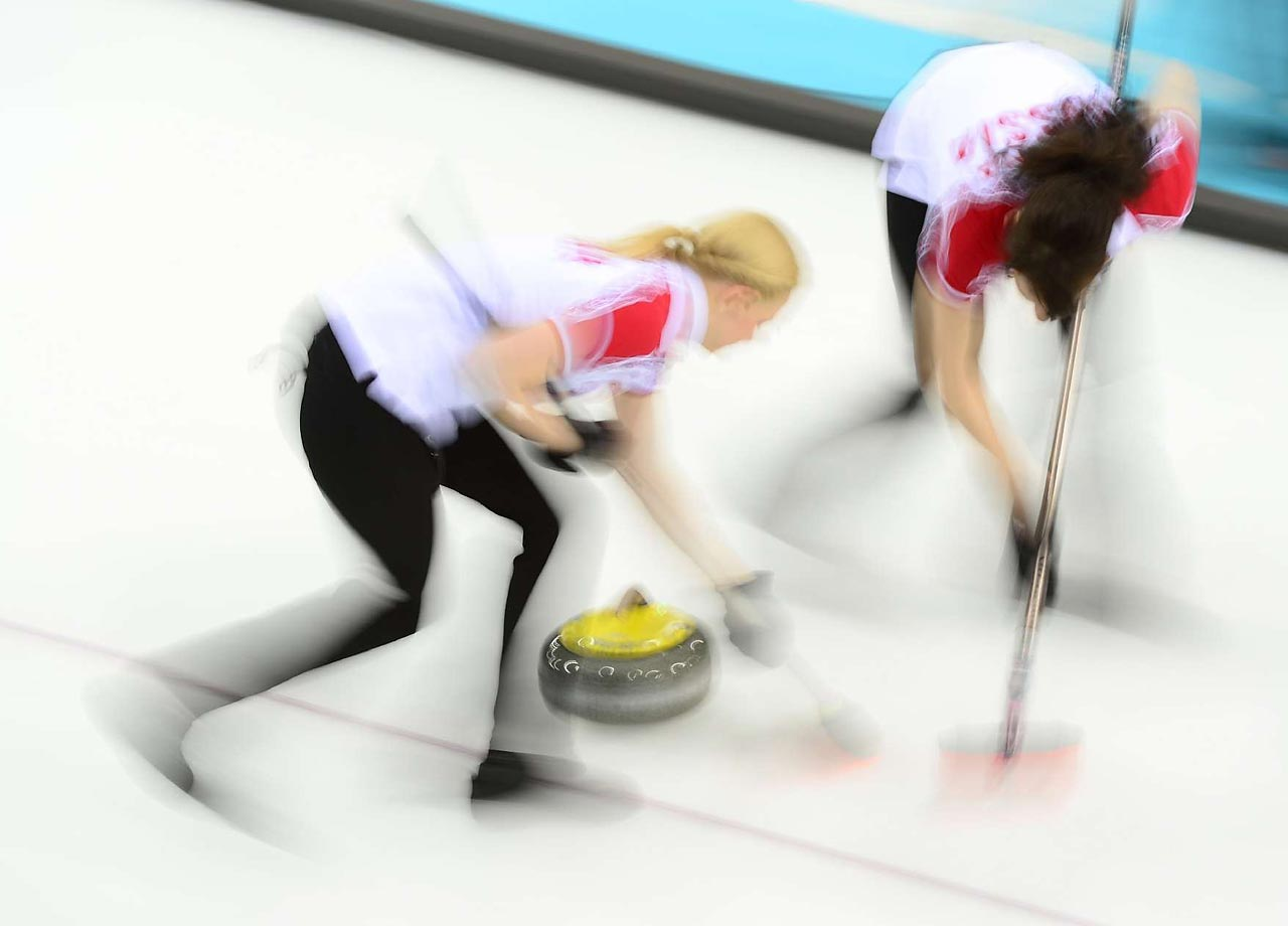 Alexandra Saitova and Ekaterina Galkina of Russia during their curling match against Japan.