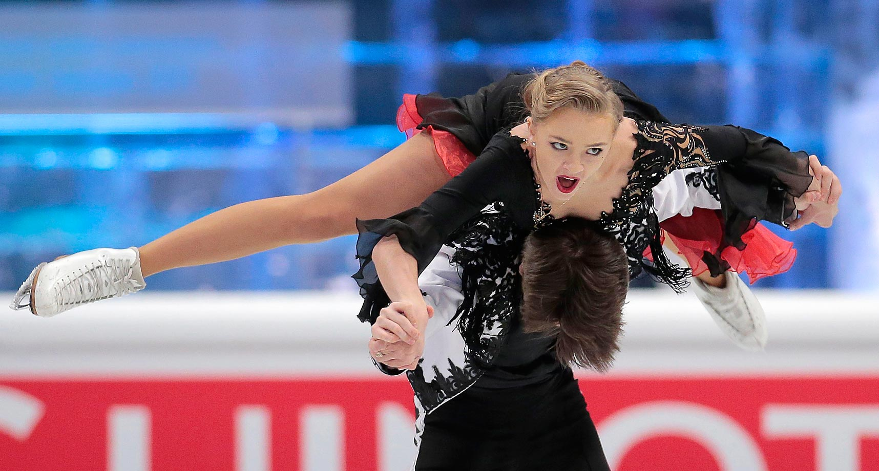 Alexandra Stepanova and Ivan Bukin of Russia skate their short dance during the European figure skating championships.