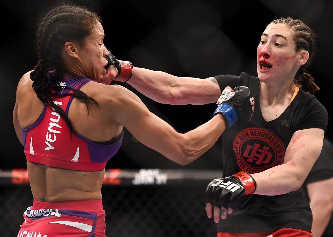 Alexis Dufresne (right) and Marion Reneau exchange punches in their bantamweight bout during UFC 182.