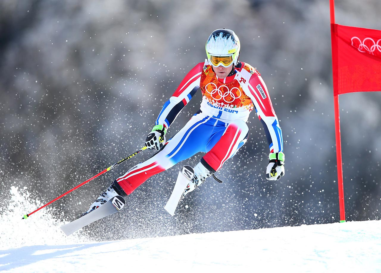 French skier Alexis Pinturalt races through the giant slalom course on his way to a bronze medal.