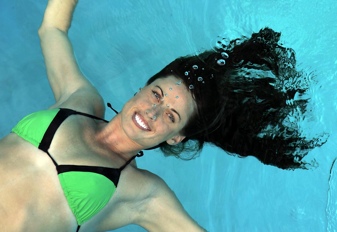 American swimmer Amanda Beard poses underwater.