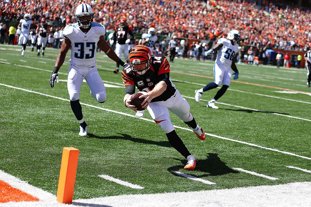 Cincinnati Bengals quarterback Andy Dalton dives into the end zone for a touchdown past Tennessee Titans free safety Michael Griffin.