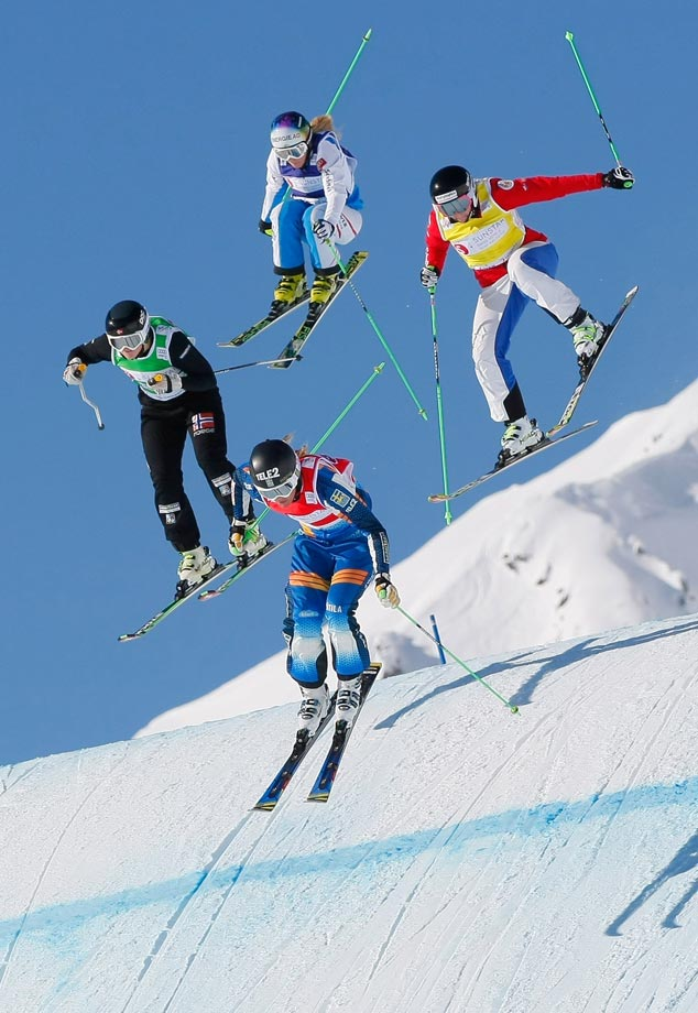 Anna Holmlund of Sweden takes 2nd place, Sofia Smirnova of Russia takes 3rd, Marte Hoeie Gjefsen of Norway takes 6th and Andrea Limbacher of Austria takes 8th during the Freestyle Skiing World Cup Ski Cross in Arosa, Switzerland.