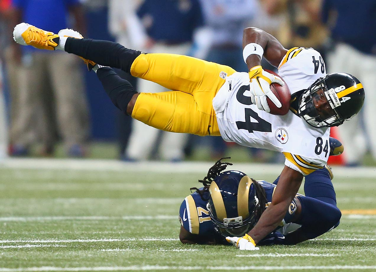 Antonio Brown is tackled by Janoris Jenkins.