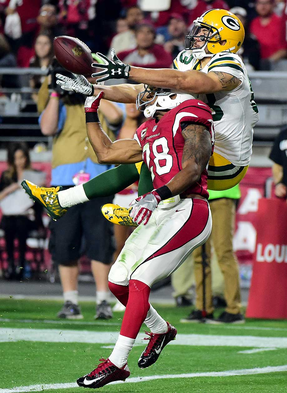 Justin Bethel breaks up a pass intended for Jeff Janis, who finished the night with seven receptions for 145 yards and two touchdowns.