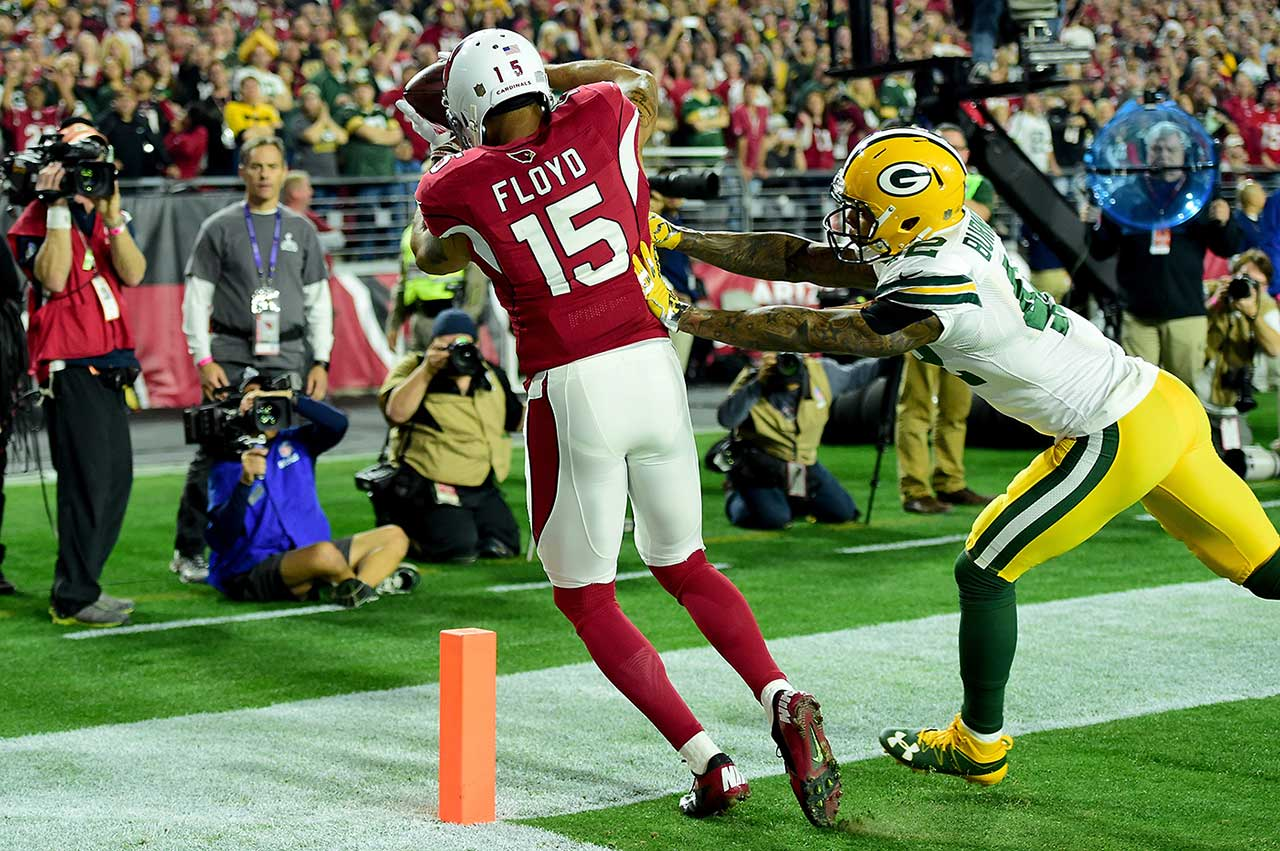 Michael Floyd turned put Arizona on the scoreboard first with this toe-tapping eight-yarder in the first half. He later caught a deflected pass for a second touchdown.