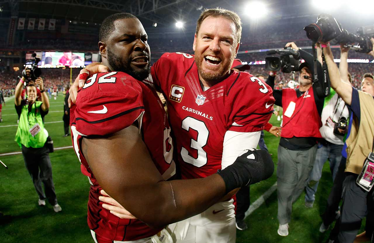 While you were sleeping, SI.com gathered some of the better photos of the Jan. 16 night in sports, beginning with quarterback Carson Palmer celebrating with defensive end Frostee Rucker after defeating the Green Bay Packers 26-20 in overtime of an NFC divisional playoff game in Glendale, Ariz.