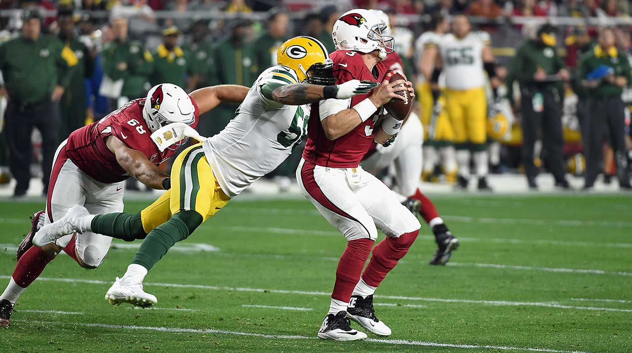Carson Palmer was sacked once and intercepted twice, but he also threw three touchdown passes.