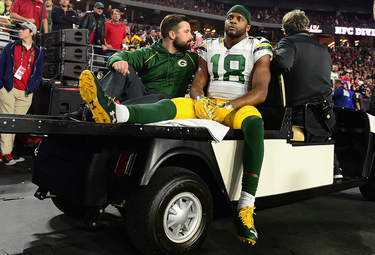 Randall Cobb was hurt while making a one-handed catch in the first half and was taken to the lockerroom.