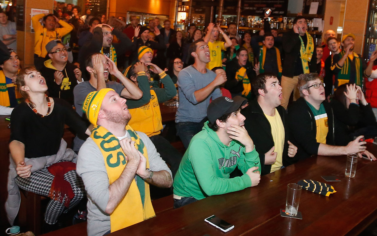 Nervous Australian fans watch the World Cup match against Chile at a bar on June 13 in Melbourne, Australia.