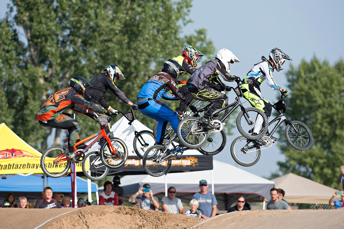 Riders attack the first jump during USA BMX's Mile High Nationals at the Grand Valley BMX in Grand Junction, Colo.
