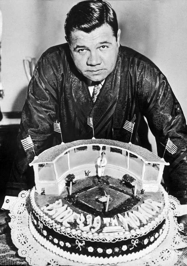 "For his 39th birthday, The Babe received a cake shaped like Yankee Stadium — ""The House That Ruth Built."""